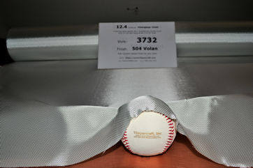 12.4 oz/sq yd style 3732 fiberglass cloth shaped around baseball