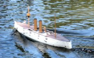 Fiberglass model ship in water with power